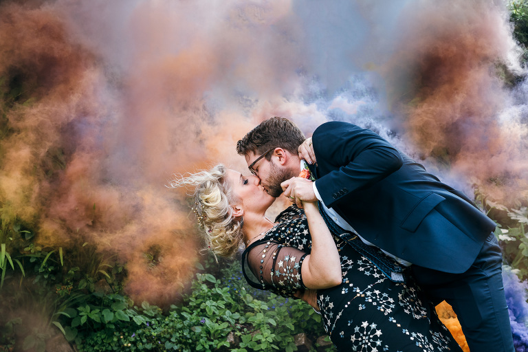 Bride and groom and smoke bomb